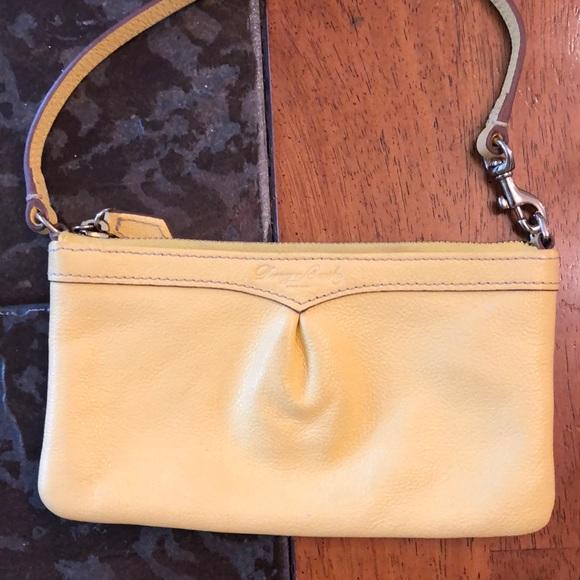 Dooney & Bourke Handbags - Dooney & Bourke wristlet yellow
